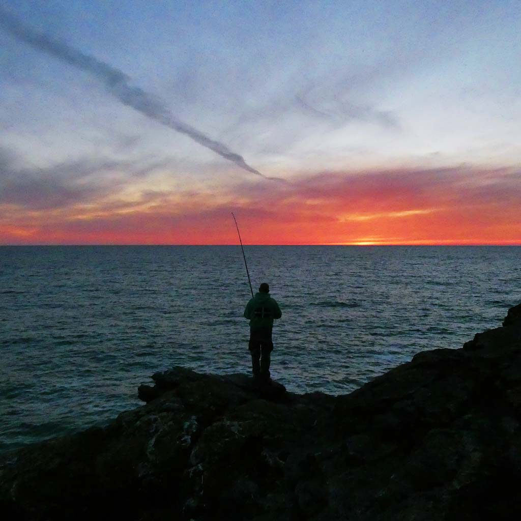 Roy reeling in cornwall rock fishing