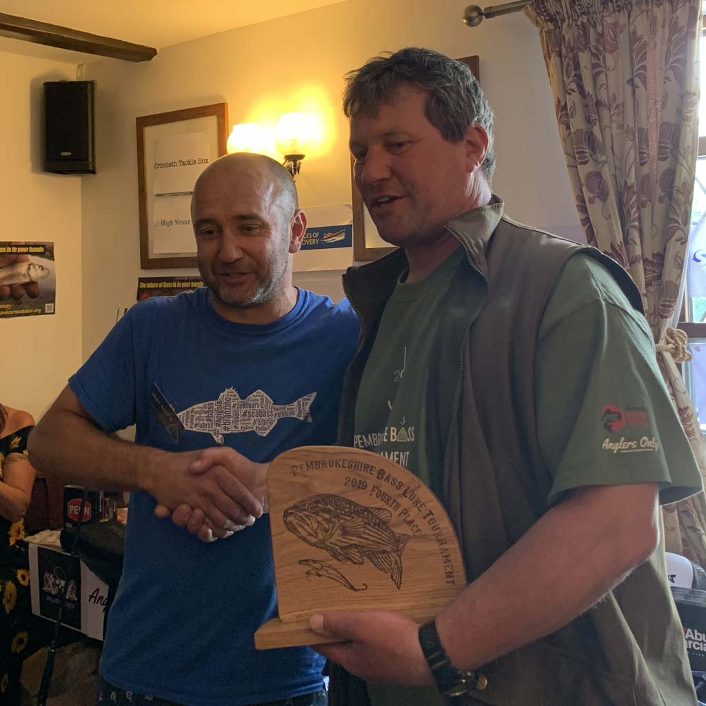 Mervyn presenting a prize at the Pembrokeshire bass lure tournament