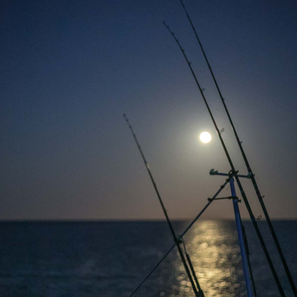 fishing sunrise on chesil beach moonlight