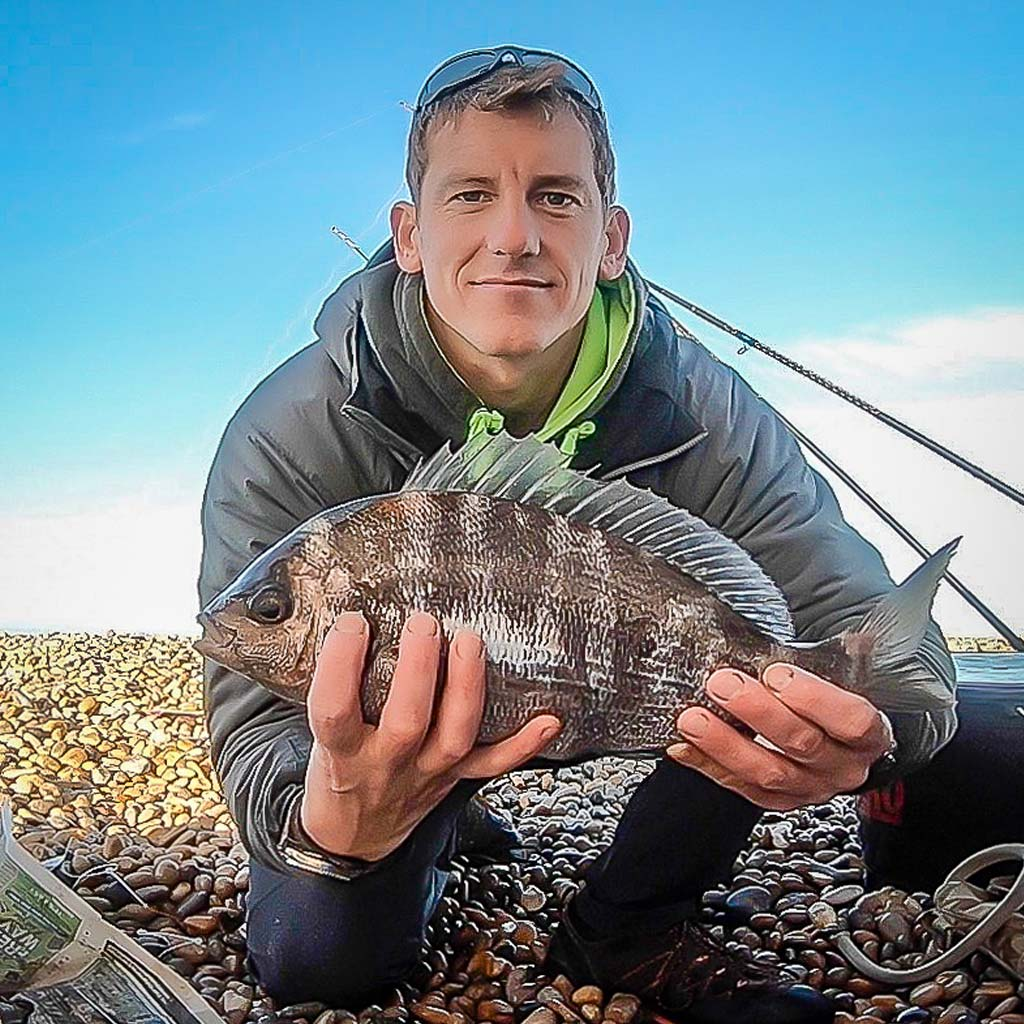 rob johansen with a black bream