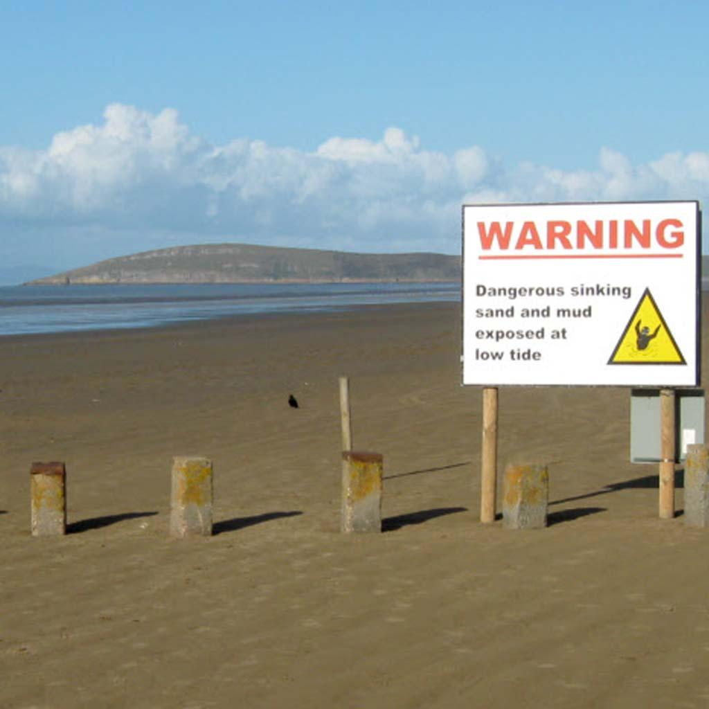 warning sign on weston beach