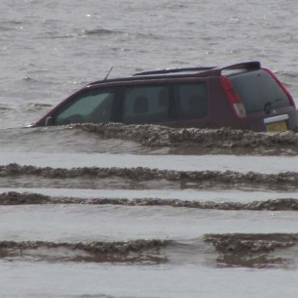 unfortunately sunken car in the sea
