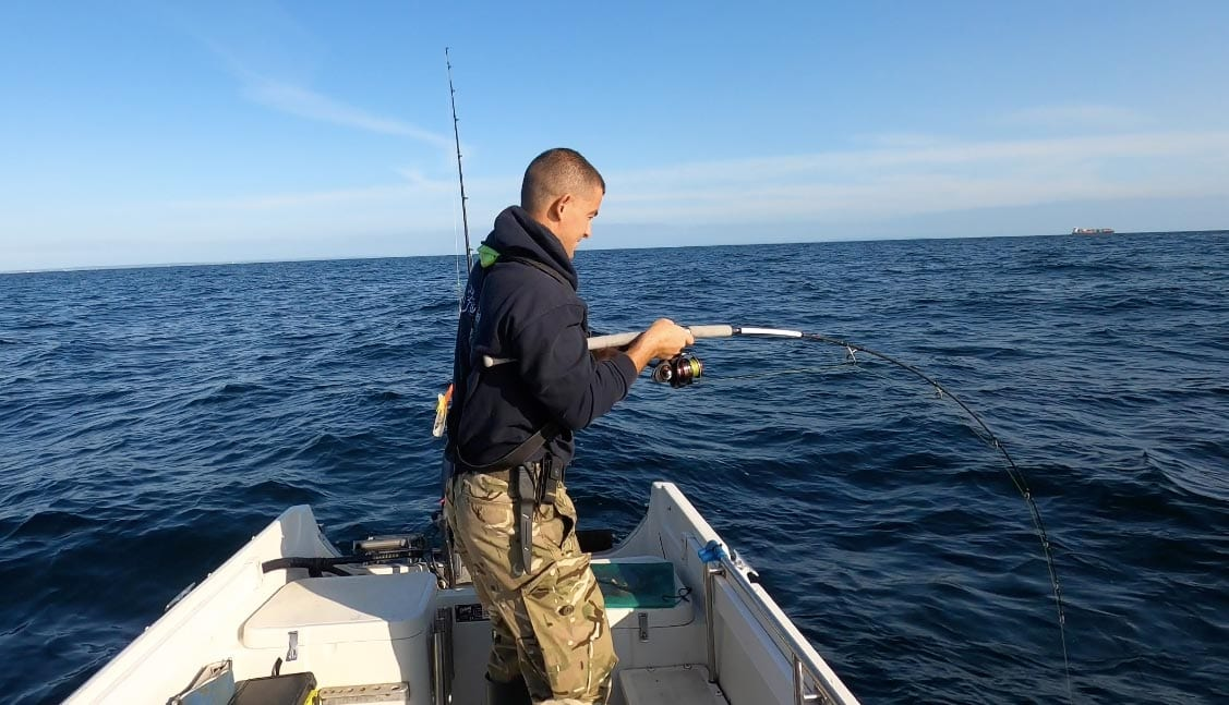 John Fishlocker puts a good bend in his rod bullying a fish up from the bottom