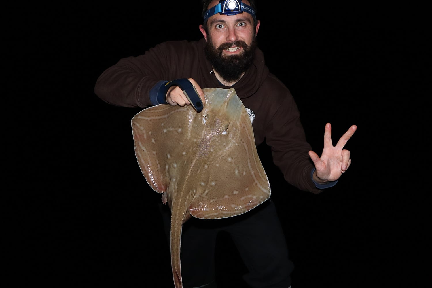 Sam Chapon holding a small jersey shore caught small eyed ray