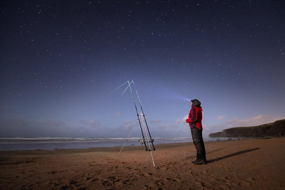 Mark Reed watches his rods beneath the stars on a Cornish surf beach