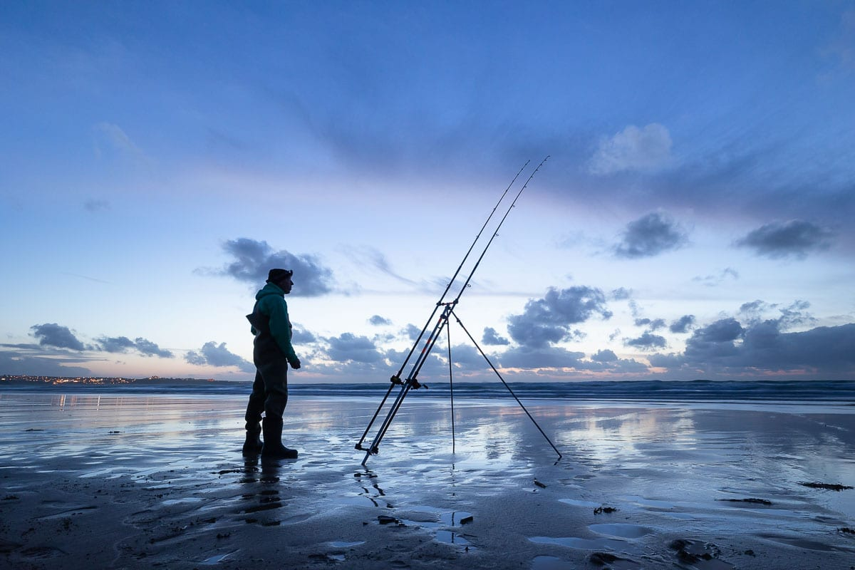 Roy Moore watches his rods closely on a Cornwall surf beach